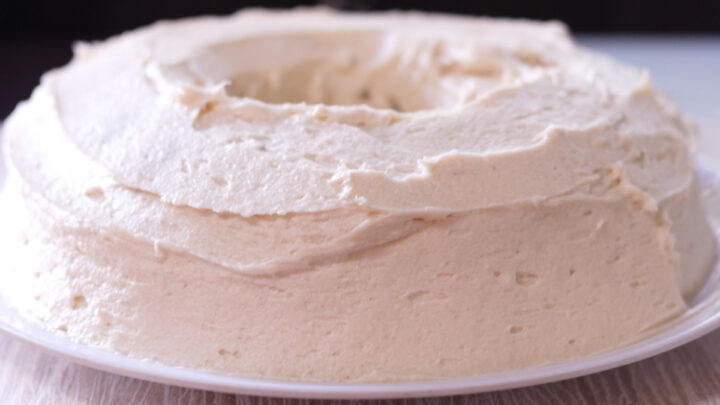 full view of frosted bundt cake