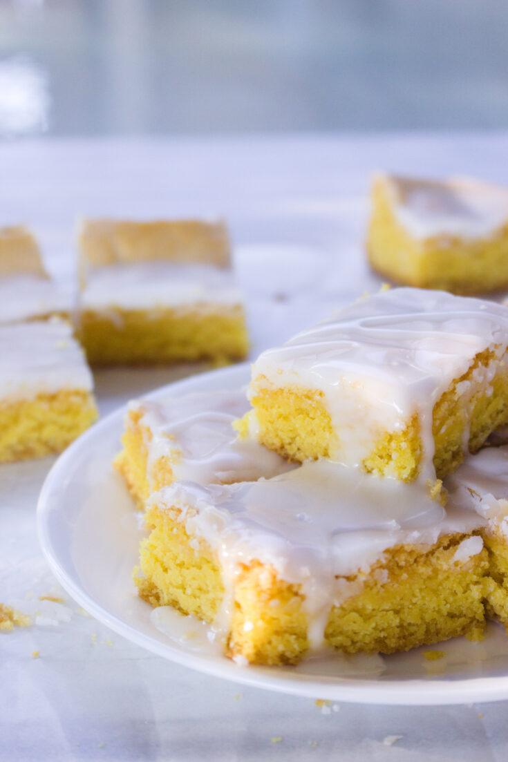 duncan hines lemon cake mix recipe lemon brownies stack on white plate 2