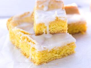 duncanhines lemon cake mix recipes lemon brownies on white plate with lemon glaze dripping down