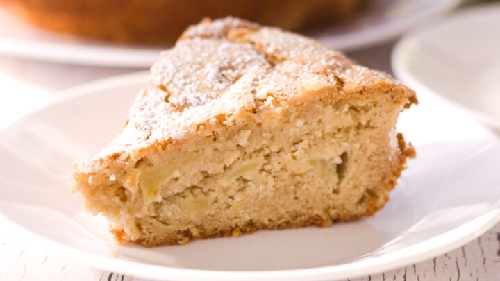 slice of french apple cake on white plate