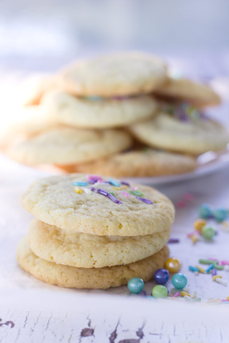 soft sugar cookie recipe without vanilla 3 cookies and plate in background