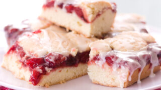 stack of cherry bars on a white plate