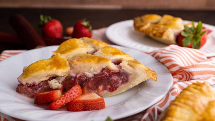 strawberry rhubarb pie on white plate
