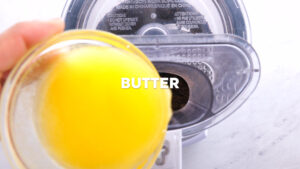 add melted butter to oreo cookie crumbs in food processor