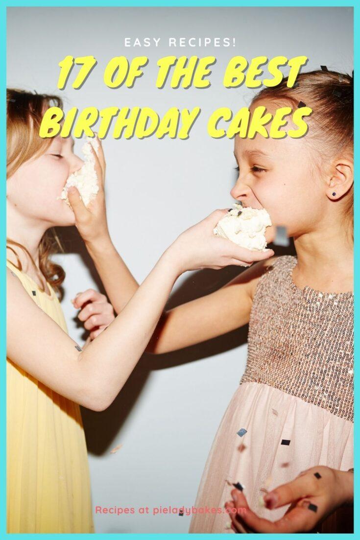 two little girls feeding each other cake
