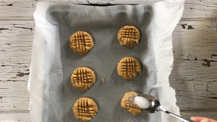 sprinkle a little bit of sugar on each cookie before baking