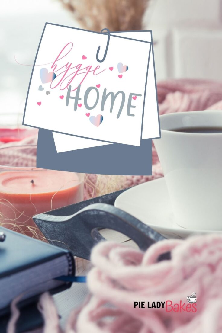 hygge home sticker on image with candles, tray, blanket, coffee mug book