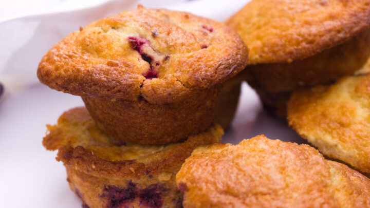 stack of mixed berry muffins feature